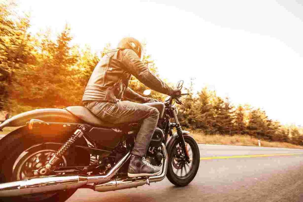 Man on a Motorcycle riding on the road
